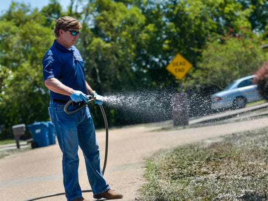 Matt Roth with Environmental Associates of Louisiana is spraying Sewper Rx, a microbial product  that will eliminate odors and drastically reduce fecal coliform and other organic contaminants from standing water and sludge from the storm. August 30, 2016