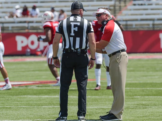 UL coach Mark Hudspeth talks to the field judge as the Cajuns open the season with a loss to Boise State.