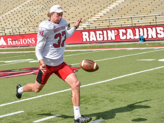 UL punter Steven Coutts, from Australia, works on his drop at Cajun Field.