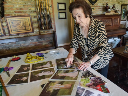 Tuttie Billeaud displaying photos that have been taken