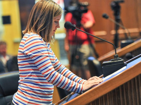 Bendel Gardens residents address the Lafayette City-Parish Council to ask that an apartment complex on Pinhook Road be denied. (Pictured- Meg Mourain)
