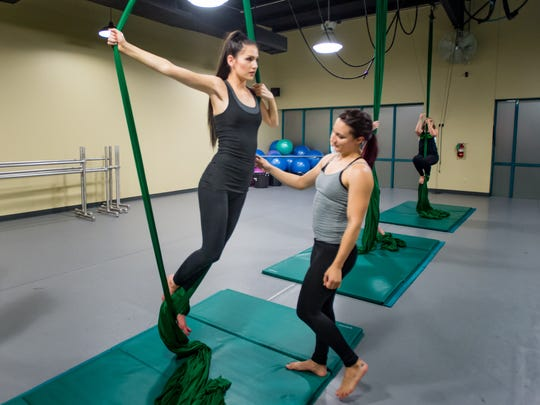 Instructor Erin Welsh (r) with Lindsey Badon at the aerial arts class at The Ballet Studio
