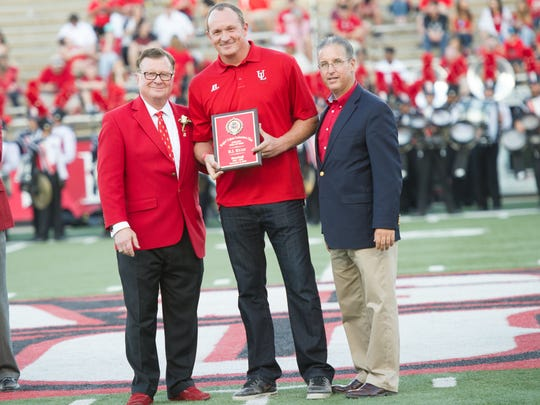 UL president Joseph Savoie, left, and athletic director Scott Farmer, right, honor new UL Hall of Famer B.J. Ryan.