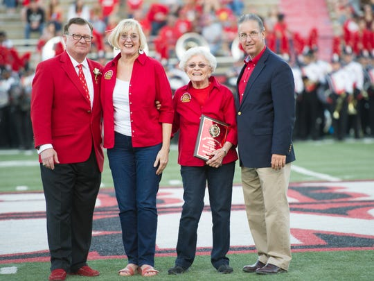 UL president Joseph Savoie, left, and athletic director Scott Farmer, right, honor the daugther Patty and wife Dolores of new Hall of Famer Beryl Shipley.