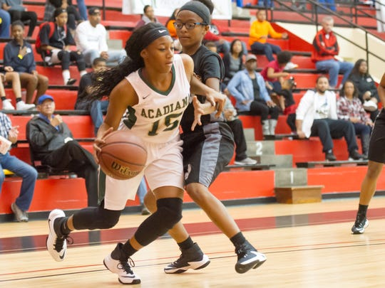 Acadiana's De'Nekqua Jackson drives to the basket against Opelousas during their  in the CASA Basketball Jamboree game Monday at Earl K. Long Gym.