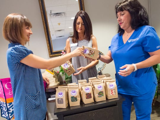 Fawn Hernandez delivers cookies baked by volunteers in memory of Mona Viator to Hospice of Acadiana. (Pictured L-R, Fawn Hernandez, Jene' Segura, Jolane Doucet)
