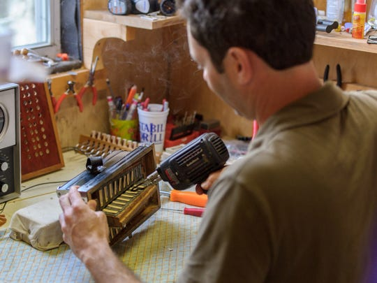 Andre Michot of the Lost Bayou Ramblers builds accordions in his spare time in his shop in Broussard-20170120 Friday, Jan. 20, 2017. SCOTT CLAUSE / USATODAY Network