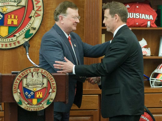 UL president Joseph Savoie, left, introduces new Ragin' Cajuns athletic director Bryan Maggard earlier this year.