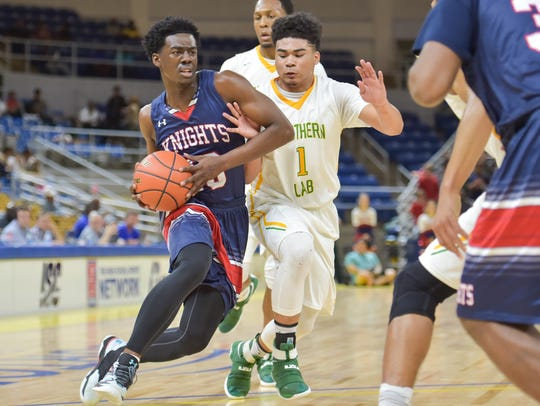 Greg Williams drives to the basket as the Lafayette