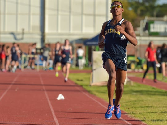Carencro's Key Alfred wins the 1600 meter run at the Oil City Relays at Lafayette High on Friday.
