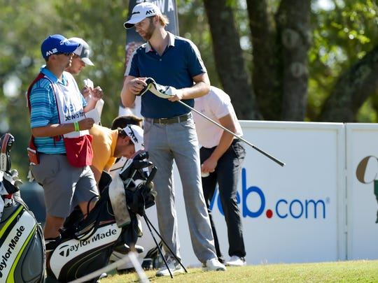 David Lutterus and caddie Ryan Desormeaux at the Chitimacha Louisiana Open presented by Nacher at Le Triomphe Golf Course. Saturday, March 25, 2017.