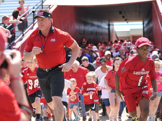 Former UL head coach Mark Hudspeth, shown here running out of the Cajun Field tunnel, brought an energy to the position that Ragin' Cajun fans had never experienced before he arrived in Lafayette in 2011.