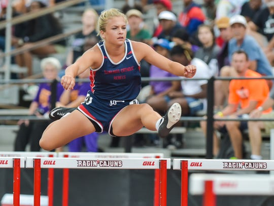 Abby Robertson competes in the 100m hurdles at the