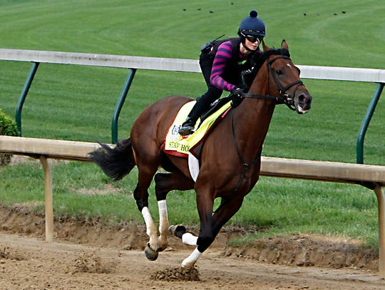 State of Honor, with exercise rider E.J. Bowler in the saddle during a workout at Churchill Downs