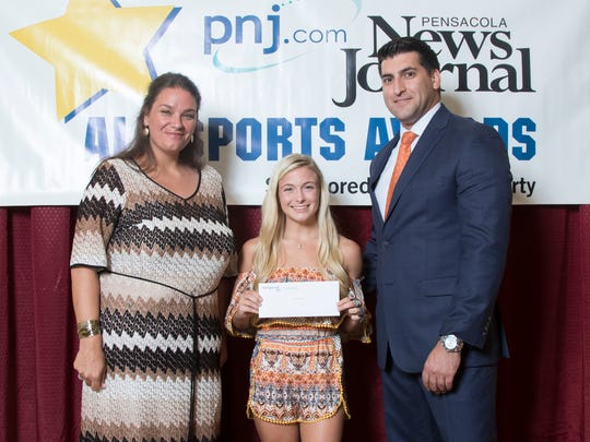 Lisa Nellessen-Savage (PNJ Executive Editor), left, and attorney Stephen Luongo (on behalf of Troy Rafferty) pose with the girl's Troy Rafferty Scholarship Award winner Payton Watson, of Navarre High School's weight lifting team, during the 11th Annual Pensacola News Journal All-Sports Awards banquet at the Saenger Theatre in Pensacola on Tuesday, June 27, 2017.