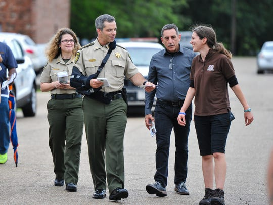 Sheriff Mark Garber and deputies with the Lafayette Parish Sheriff's Office occasionally walk neighborhoods in the parish, meeting residents. File photo from June 12, 2017.