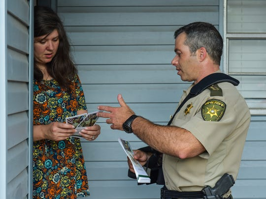 Sheriff Mark Garber speaking with Jenny Morgan walking neighborhoods in Acadiana meeting and talking with residents.  Monday, June 12, 2017.