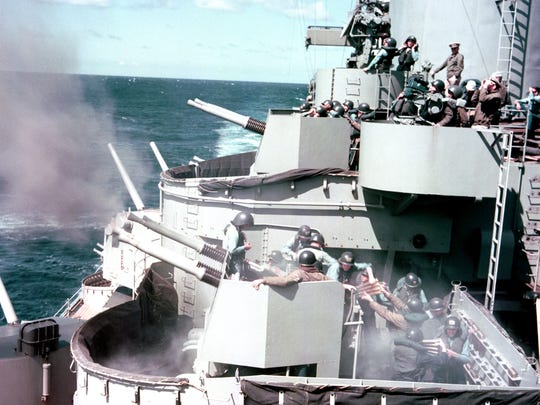 Battleship New Jersey sailors practice firing  Quad 40mm guns off the coast of North Korea during the Korean War in the early 1950s (bottom of photo)
