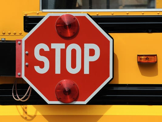 Stop Sign on Yellow School Bus