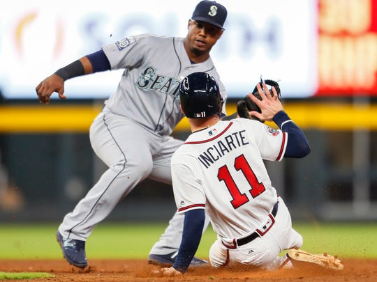Atlanta Braves Ender Inciarte  is caught stealing second by Seattle Mariners shortstop Jean Segura in the ninth inning Monday, Aug. 21, 2017, in Atlanta.