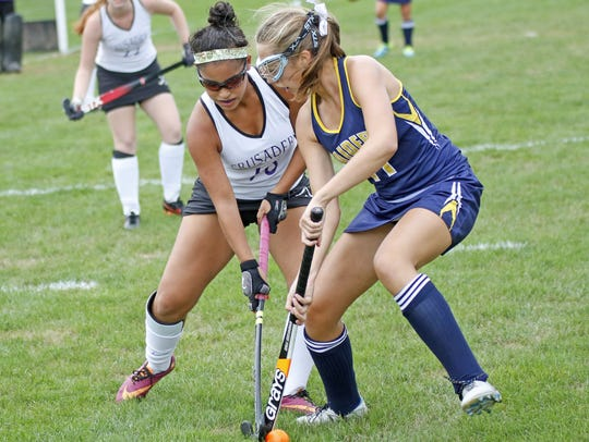 Elco's Abbie Keath, right, had six goals and four assists