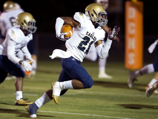 Independence running back Troy Henderson (21) brings