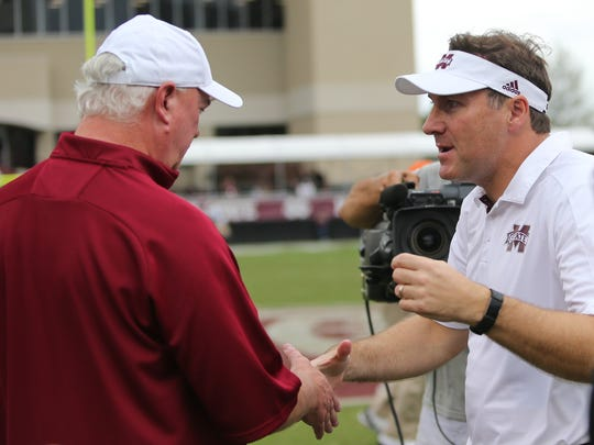 UMass head football coach Mark Whipple (left) and Mississippi State head football coach Dan Mullen meet following the game. Mississippi State and UMass played in a college football game on Saturday, November 4, 2017 in Starkville. Photo by Keith Warren