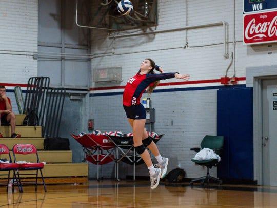 Cicily Hidalgo jump serves as Teurlings Rebels Volleyball