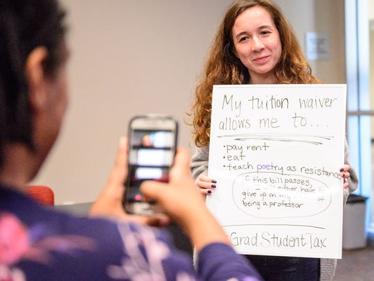 UL Graduate Student Emily de Beer posting twitter photo during the informational forum to discuss the proposed Tax Bills that have been introduced in the U.S. Congress. Thursday, Nov. 30, 2017.