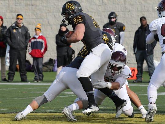 Genoa graduate David Nutter tries to break a tackle