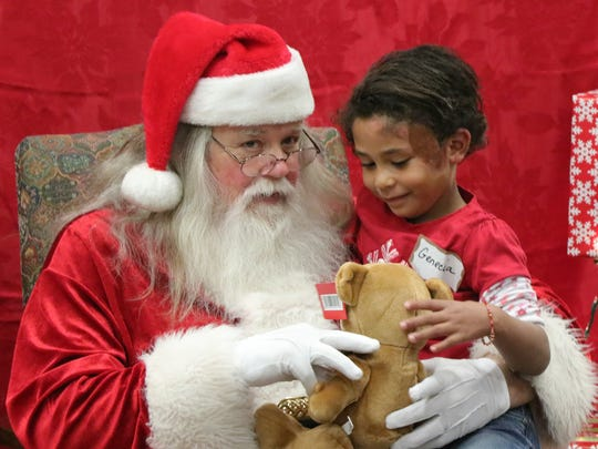 After his burn injury, Hill (Santa) enjoys giving his