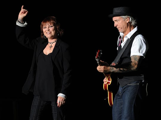 Neil Giraldo and his wife Pat Benatar perform live in concert at the Cruzan Amphitheater on October 12, 2012 in West Palm Beach ,Florida. (Photo by Invision/AP)