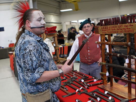 Daniel Youngberry of Oshkosh, dressed in traditional Meskawki Indian face paint, checks out the tomahawks at the Echoes of the Past historical trade fair in this file photo. This year's event is Feb. 24 and 25.