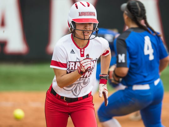 Cajuns outfielder Brittany Rodriguez (6) able to lay the bunt down for the base hit as the Ragin Cajuns softball team play Memphis on Sunday afternoon Feb. 25, 2018.