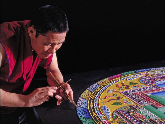 To create a sand mandala, the monks carefully place millions of grains of colored sand to form the design. It's a process that takes days or weeks.