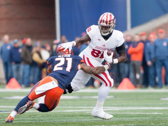 Indiana Hoosiers tight end Ian Thomas worked last fall to avoid Illinois defensive back Patrick Nelson.