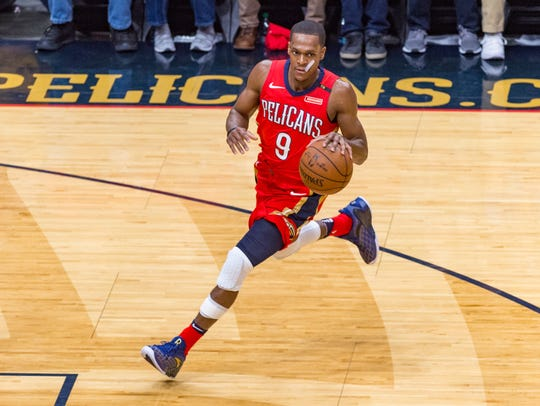 Rajon Rondo passes the ball as The New Orleans Pelicans