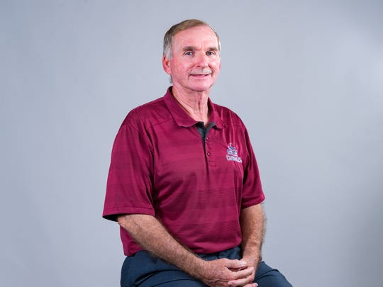 St. Thomas More head baseball coach Gary Perkins is the All-Acadiana Coach of the Year.
