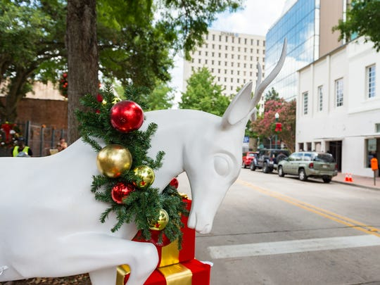 Christmas decorations  as film crew shoots movie in downtown Lafayette. Tuesday, June 12, 2018.