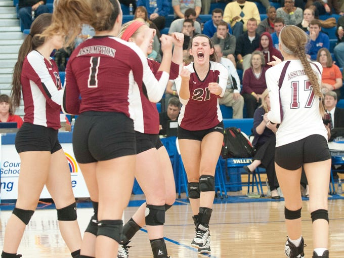 Assumption Rockets' Alexa Filley, center, erupts in celebration with her teammates as Assumption beats Note Dame, 25-18, 25-13 and 28-26, to win the KHSAA 2013 Volleyball Championship held at Valley High School. Nov. 10, 2013