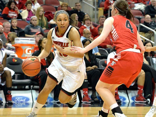 Louisville's Tia Gibbs, left, attempts to drive around the defense of Austin Peay's Kristen Stainback during the second half of an NCAA college basketball game Saturday Dec. 14, 2013, in Louisville, Ky. Louisville defeated Austin Peay 108-53. (AP Photo/Timothy D. Easley)