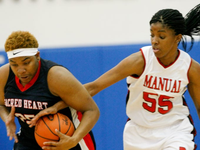 Sacred Heart's Daijia Ruffin, #25, and Manual's Krystalline McCune, #55, go for a loose ball during their game at the Valley High School. Mar. 6, 2014