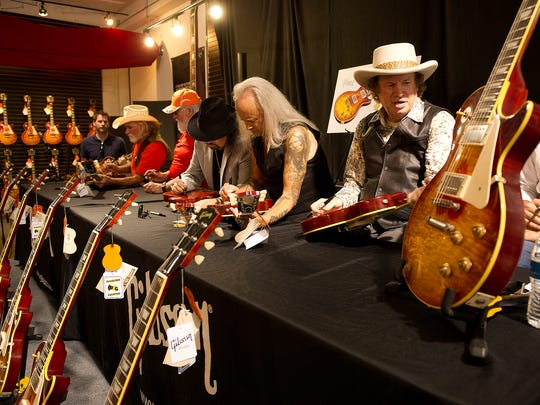 Southern rock legends Dickey Betts, Charlie Daniels, Gary Rossington and Rickey Medlocke of Lynyrd Skynyrd  and Jimmy Hall autograph guitars at a tribute event to introduce the Gibson Custom Southern Rock Tribute 1959 Les Paul guitar Monday, May 19, 2014, in Nashville.