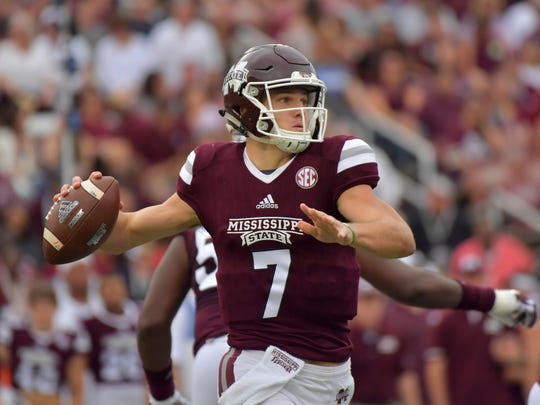 Mississippi State quarterback Nick Fitzgerald (7) throws a pass against Kentucky during the first half at Davis Wade Stadium.