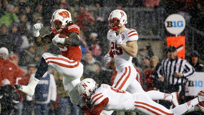 Wisconsin's Melvin Gordon breaks away from Nebraska's Corey Cooper for  a 26-yard touchdown in the third quarter.