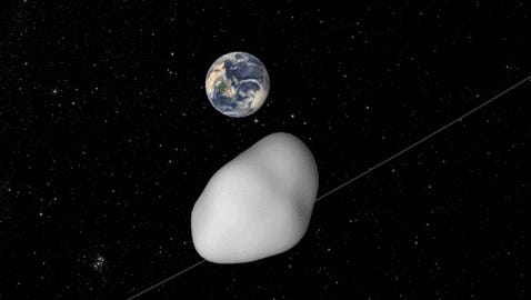 An artist's conception of an asteroid as it passes near Earth on Oct. 12, 2017. While scientists cannot yet predict exactly how close it will approach, they are certain it will come no closer than 4,200 miles from the Earth's surface.