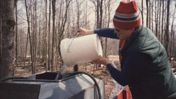 Reporter James Bruggers pouring sap at his parents' Michigan sugar bush in the early 1980s.