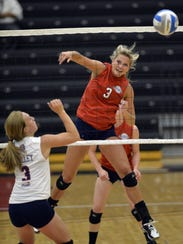 Rocori's Morgan Koshiol (3) of the red team spikes