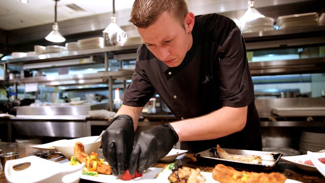 Sea Salt corporate chef Jason Goddard, shown preparing a dish in July 2015 at the Naples restaurant, will lead the culinary team for Dorona, the fourth addition to Fabrizio and Ingrid Aielli's family of upscale restaurants.