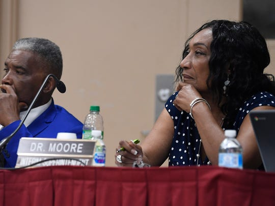 Montgomery School Board President Robert Porterfield and Superintendent Ann Roy Moore look on as AdvancEd  presents its findings to the Montgomery School Board in Montgomery, Ala. on Wednesday May 30, 2018.
